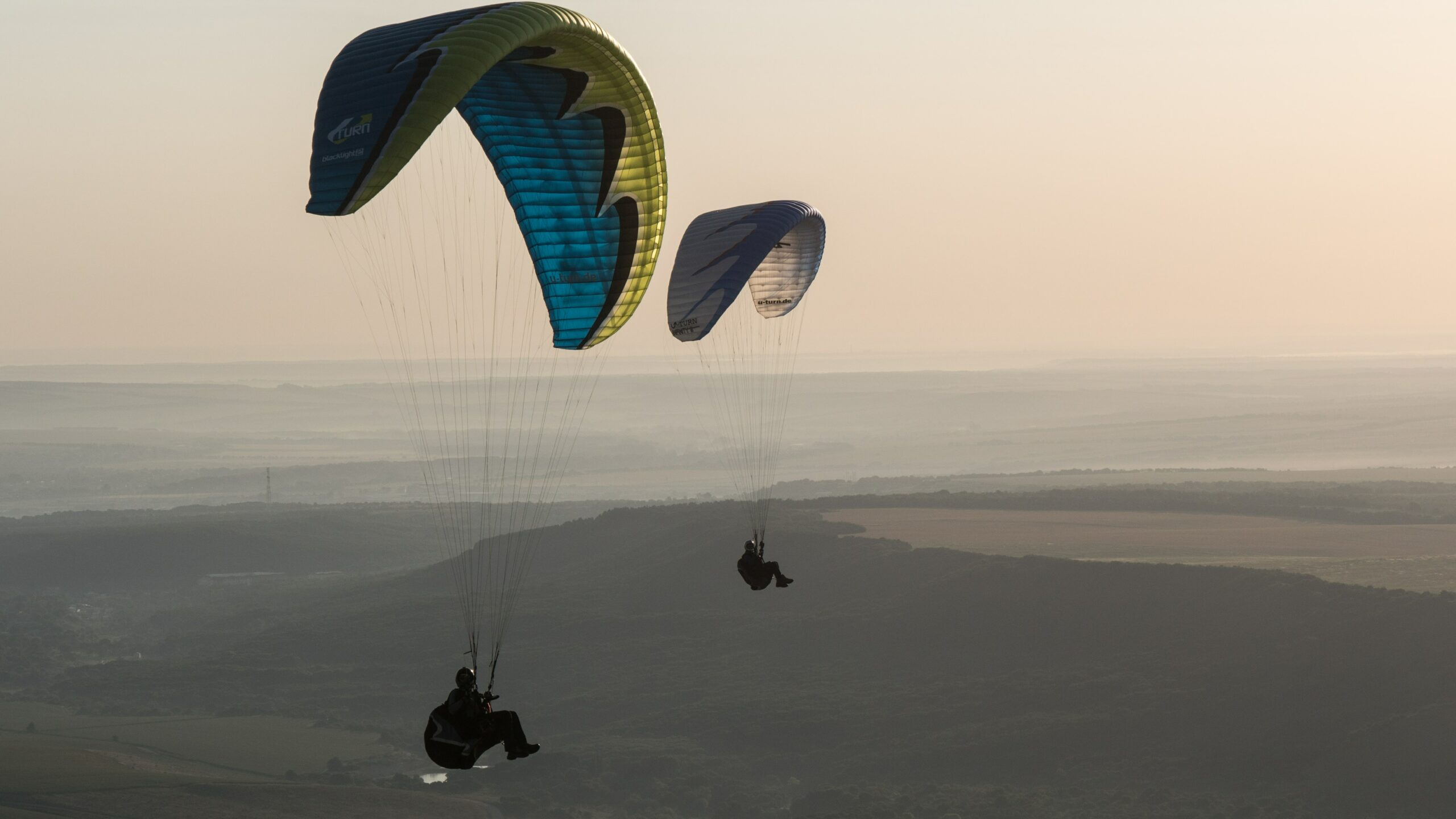 Two-people-with-parachutes-side-by-side