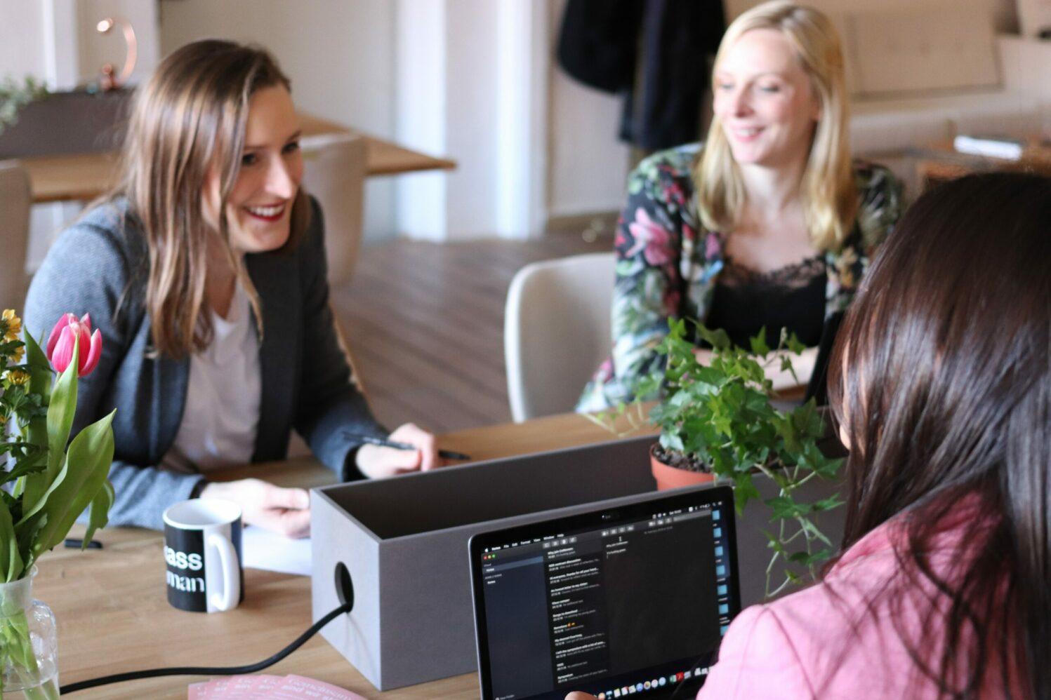 three-women-talking-at-the-desk